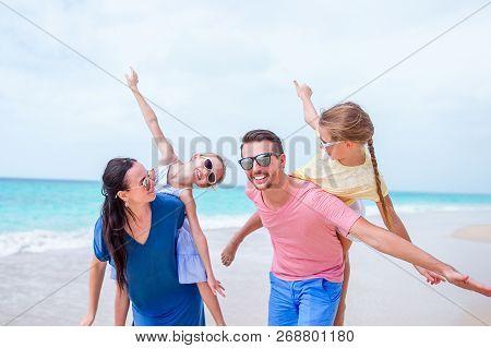 Happy Beautiful Family On The Beach On Caribs