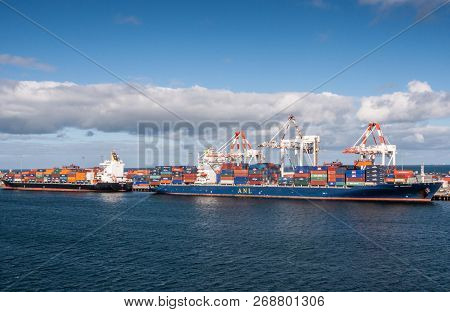 Fremantle, Australia - November 25. 2009: Two Container Ships Unload At The Sea Harbor Under Blue Sk