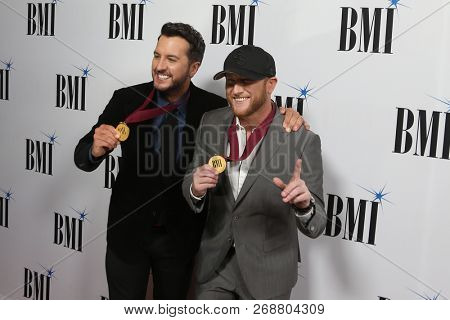 NASHVILLE, TN - NOV 13: Luke Bryan (L) and Cole Swindell attend the BMI Country Awards 2018 at BMI Nashville on November 13, 2018 in Nashville, Tennessee.