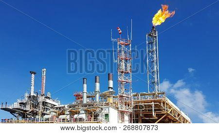 Gas Or Flare Burn On Offshore Platform. Offshore Construction Platform For Production Oil And Gas,oi