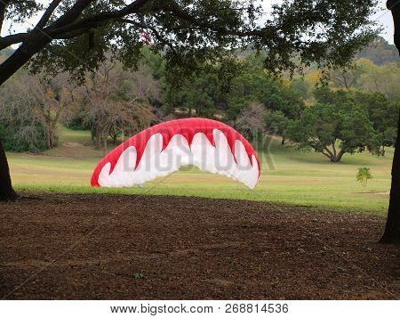 A Para Sail Catches Wind On A Park Hillside. The Pilot Was Learning How To Control The Flow Of Air F