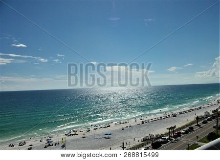 Blue Skies Meet The Waters Of The Gulf Of Mexico At The Distant Horizon Above The Beaches Of The Eme