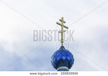 Orthodox Church Dome With A Cross On The Background Of A Cloudy Sky.