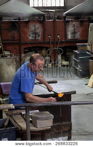 Venice,italy -  ‎april‎ ‎15‎, ‎2018: Craftman Working At A Traditional Glass Factory In Murano Islan