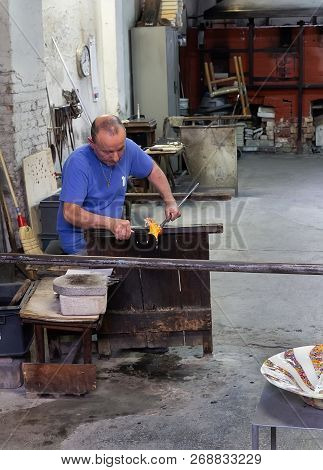 Venice,italy -  ‎ ‎april‎ ‎15‎, ‎2018: Craftman Making Glass Horse At A Traditional Glass Factory In