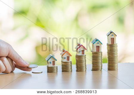 Hand Putting Money Coin Stack With Small House, Purchase Of Habitation, Buy A House,risk, Assets, Pr