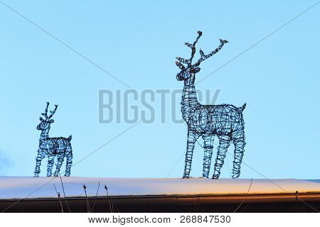 wire reindeer adorn the roof of the new year poster