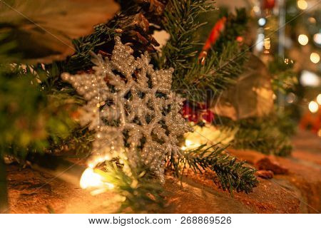 Snowflake Ornament Decor On Brick Mantel For Christmas With Lights Background