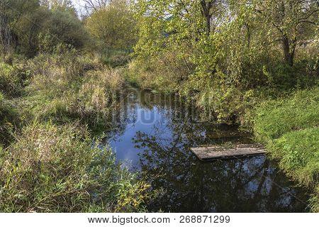 A Small River Ukhtanka In The Village Of Vyatskoe On A Sunny Autumn Day, Yaroslavl Region, Russia.