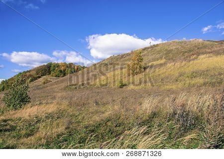 Bright Autumn Landscape With A Cross On A Mountain On A Sunny Day.
