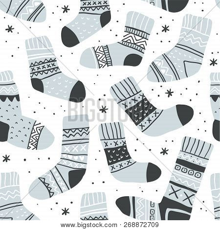 Winter Vector Seamless Pattern With Cute Socks And Snowflakes On White. Funny Doodle Socks With Diff