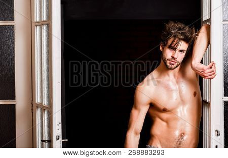 Man Confident Lover Near Door. Sexy Bachelor Lover Concept. Sexy Attractive Macho Tousled Hair Comin