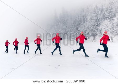 Girls Running Together On Snow In Winter Mountains. Sport, Fitness Inspiration And Motivation. Happy
