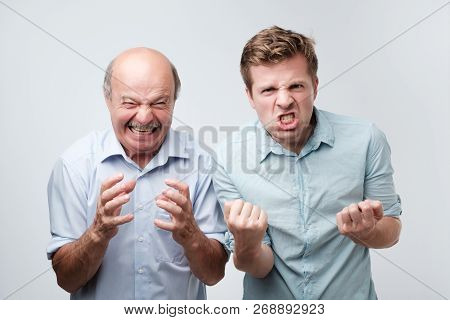 Furious Angry Two Men Exclaim With Negative Emotions Shout Loudly, Over White Studio Wall