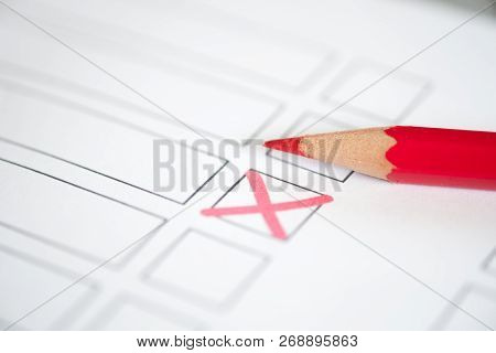 Close Up Voting Bulletin With Red Pencil. Concept Of Election. Photo With Shallow Depth Of Field