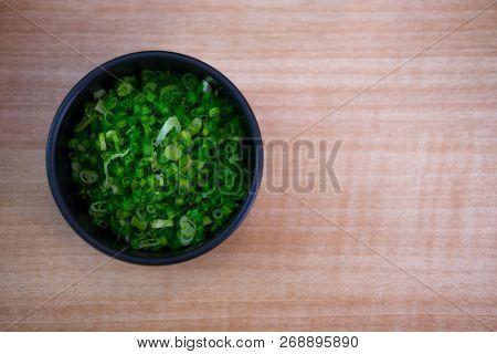 Onion Green Fresh Sliced In Black Bowl For Taste