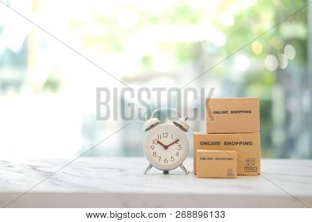 Miniature Package Box And Mini Watch With Service Mind. Fast And Easy Online Shopping Concept