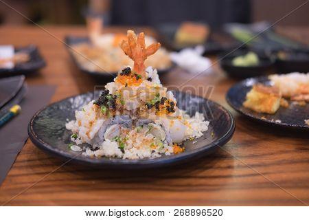 Shrimp Tempura Roll In Dish. Japanese Sushi Roll