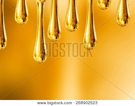 Liquid Drops Of Motorcycle Oil On Orange Background