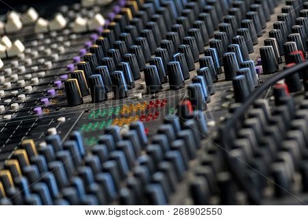 Close Up Shot Of A Mixer Desk With Many Knobs
