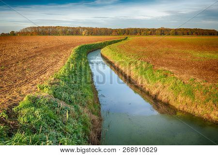 Dutch Plowed Fields Intersected By A Meandering Ditch. The Colors Have Been Artificially Changed By