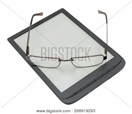 The Glasses Are Lying On The Book Reader On White Background