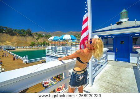 Happy Woman With American Bikini At Malibu Pier In California West Coast, United States. Caucasian G