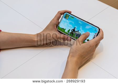 Elva, Estonia - November 15, 2018: Girl Is Holding Iphone With Online Fortnite Game On Display, Play