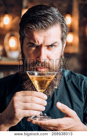 Barman With Martini Or Liquor. Bearded Man Wearing Suit And Drinking Alcohol. Drink And Celebration