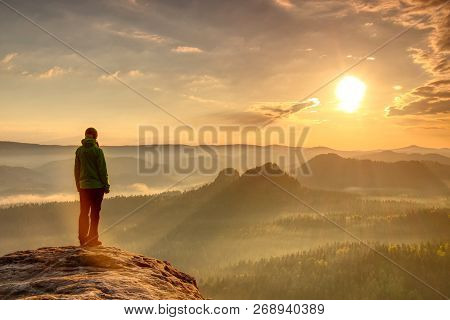 Woman Hiking Silhouette In Mountains, Sunset And Fall Landscape. Female Hiker Looking Over Edge  At