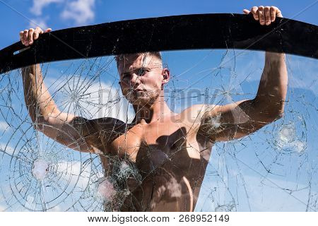 Ambition Wings His Spirit. Focus On Building Strength And Power. Strong Man Hold Cracked Glass. Spor