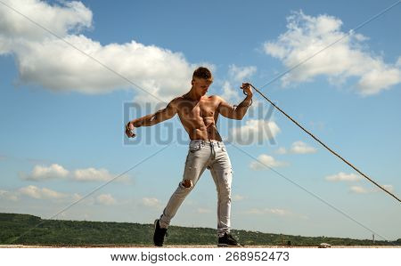 Ambition Is The Path To Success. Athlete With Fit Sexy Torso. Strong Man Pull Rope. Sport Man Develo