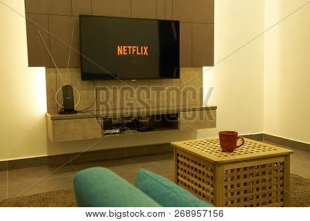 KUALA LUMPUR, MALAYSIA - November 11TH, 2018 : Modern lifestyle with Philips Android TV to stay connected & browsing media using favourite Apps. Tv display netflix app loading