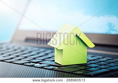 Smart House Concept, Green House On Laptop Keyboard. Idea Smart House, Eco Technology, Computer Moni