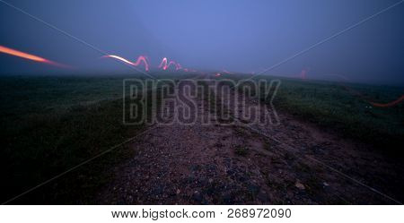 Light Painting with pocket lamp in night landscape. long exposure lights light painting night nature landscape. Light painting at the field
