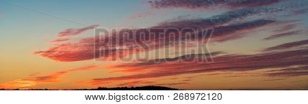 Panorama of the sky during sunset. Nature background of the colorful panorama sky