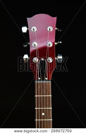 electric guitar head, black background
