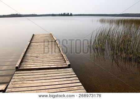 Northern Lake Canada Dock In Wilderness Manitoba Duck Mountain