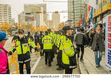 Seoul, South Korea; November 10, 2018: Unidentified Group Of Koreans Gather For Rally While Police W
