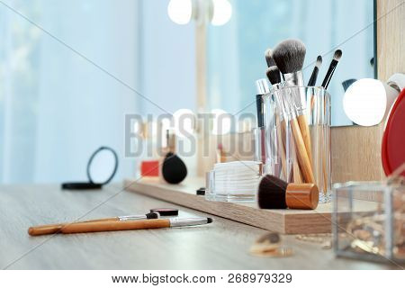 Organizer With Cosmetic Products For Makeup On Table Near Mirror. Space For Text