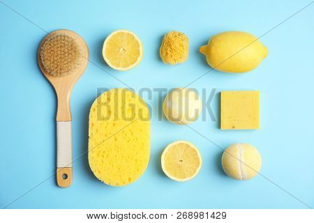Flat lay composition with bath bombs, toiletries and lemons on color background poster