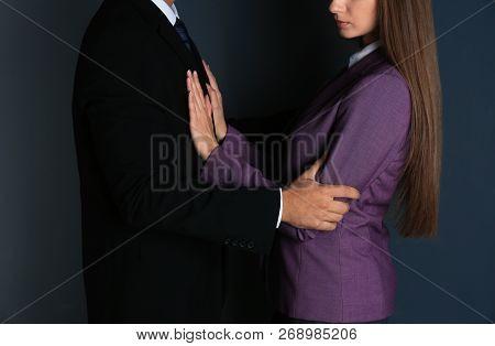 Boss Molesting His Female Secretary On Dark Background, Closeup. Sexual Harassment At Work