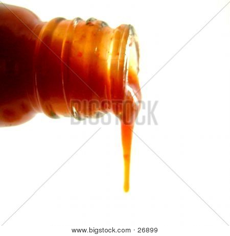 Tomato Ketchup Dripping From Bottle