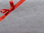 red bow on silver background poster