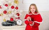 Christmas ball traditional decor. Kids can brighten up christmas tree by creating their own ornaments. Top christmas decorating ideas for kids room. Child red costume hold christmas ornament ball poster