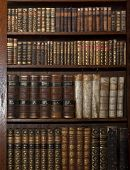 historic old books in a old library poster