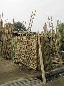 Baans mandi or the Bamboo market of Lucknow India. Artifacts such as grills ladders poles etc. made of dried bamboo stems. poster
