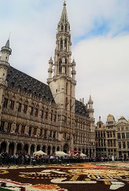 Brussels, Belgium - August 19, 2018: A Vertical Shot Of The Famous Clock Tower On Town Hall In The G