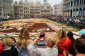 Brussels, Belgium - August 19, 2018: People Take Cell Phone Pictures At The 2018 Brussels Flower Car