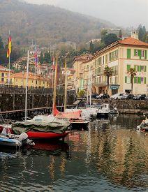 Menaggio, Italy - April 8, 2018: Menaggio Marina In The Morning. Fishing And Sail Boats Anchored In